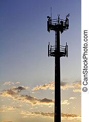 GSM Antenna - Silhouette of GSM transmitter tower at sunset....