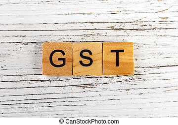 GST word made with wooden blocks Business Concept