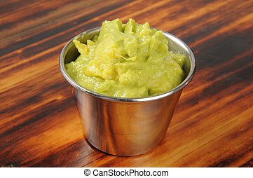 Closeup of resh guacamole in a silver cup