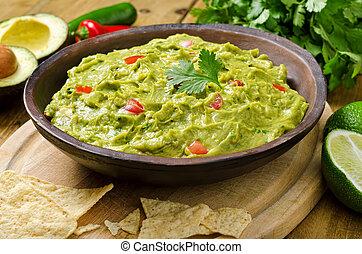 Guacamole Dip - Guacamole with avocado, lime, tomato, and...