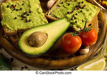 guacamole - Guacamole sandwich with fresh avocado fruit on a...