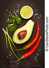 Guacamole ingredients. - Ingredients for guacamole dip on a...