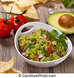 Guacamole with avocado, lime, tomato and cilantro with...