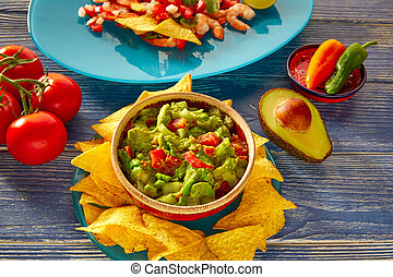 Guacamole with avocado tomatoes and nachos