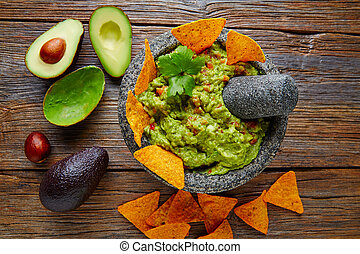 Guacamole with nachos in Mexican molcajete - Guacamole with...