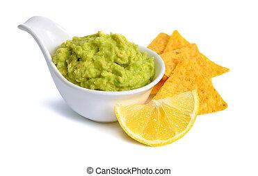 Guacamole with nachos. Isolated on white background