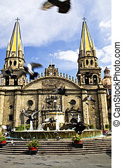 Pigeons flying in front of the Cathedral in historic center in Guadalajara, Jalisco, Mexico