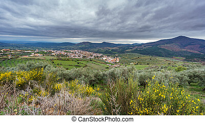 Guadalupe abbey and village with cloudy sky - Detailed view...