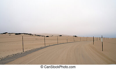 Guadalupe-Nipomo, CALIFORNIA, UNITED STATES - OCT 8, 2014: sand dunes and a street within the National Park in CA along Highway No 1, USA