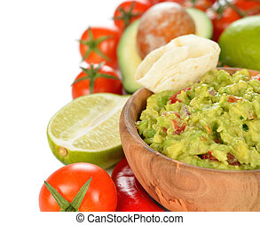 Guakamole and fresh vegetables on white background