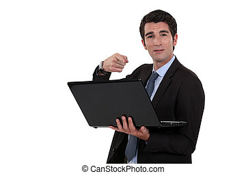 guapo, hombre de negocios, con, computador portatil