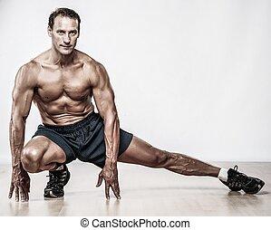 guapo, muscular, hombre, hacer, estirar el ejercicio