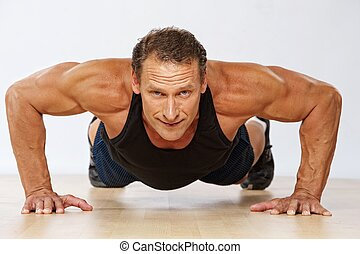 guapo, muscular, hombre, hacer, push-up.