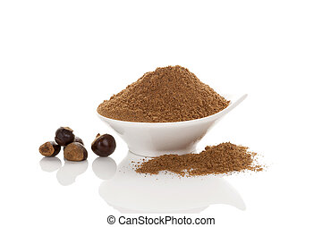 Guarana seeds and powder in bowl. Isolated on white...