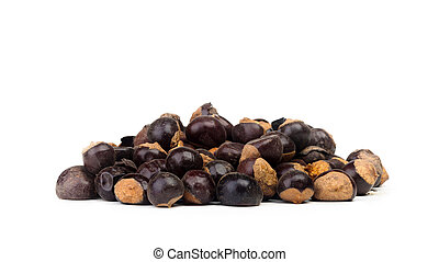 Guarana seeds isolated on white background photographed with...