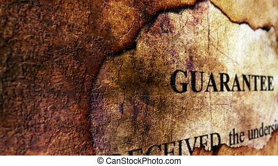 Guarantee text on paper hole grunge concept