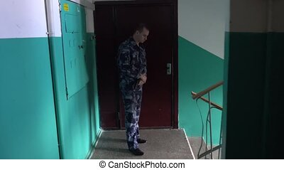 Guard dressed in military uniform don't let a news camera...
