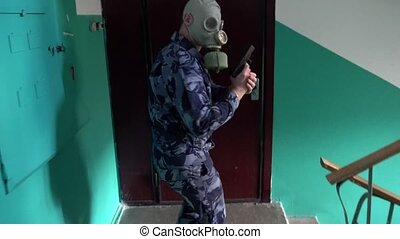 Guard dressed in military uniform in a gas mask the storming...
