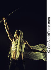 Mighty and brave angel posing with katana over dark background