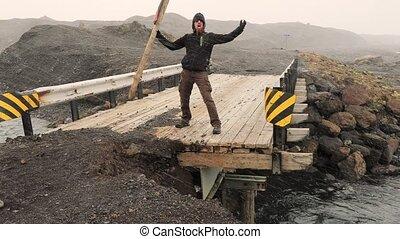 Guarding the passage on a broken bridge - Standing on a...