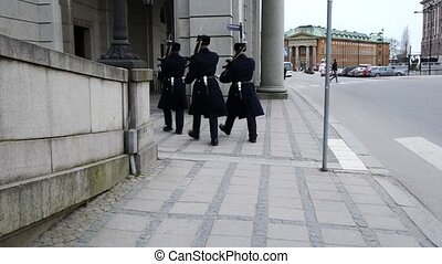Guards walking in the streets of Stockholm, Sweden