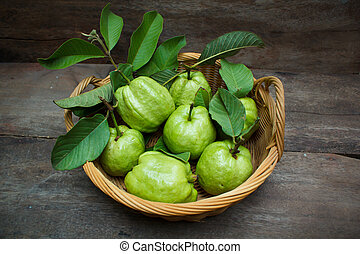 Guava. - Fresh green guavas on old wood background.