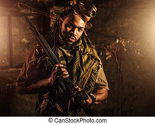 guerrilla freedom fighter with gun in bunker