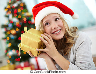 Guessing - Portrait of happy girl holding giftbox and...