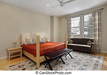 Guest bedroom with orange bedspread