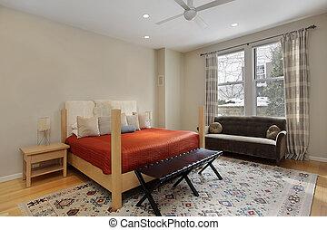 Guest bedroom with orange bedspread