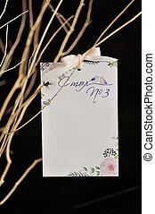 Guest list on branch with dark background