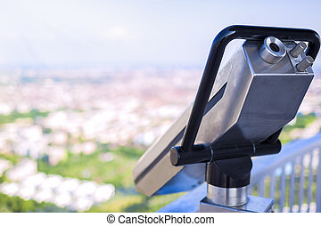 Guest tourist binoculars at Olimpiapark Tower in front of aerial Munich  Skyline, Munich, Germany. Horizontal Image