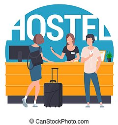 Guests at hostel lobby - Pair of young travellers standing...