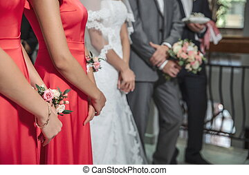 guests at the wedding, bridesmaids in red dresses