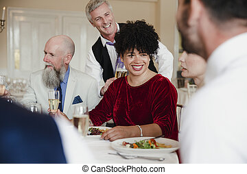 Guests Enjoying The Meal At a Wedding