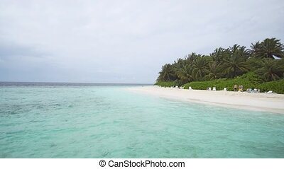 Guests on Luxury Resort's Private Beach in the Maldives -...