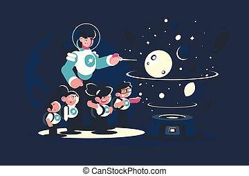 Guide with school children in planetarium