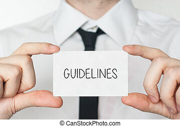Guidelines. Businessman in white shirt with a black tie showing or holding business card