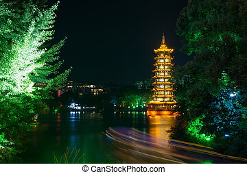 Guilin tower with light trails from a boat