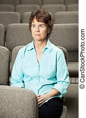 Guilt and Repentence - Mature woman in empty church, praying...