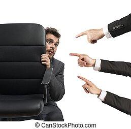 Concept of businessman culprit behind a chair