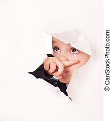 Guilty looking kid in a hole in white paper - Guilty kid...