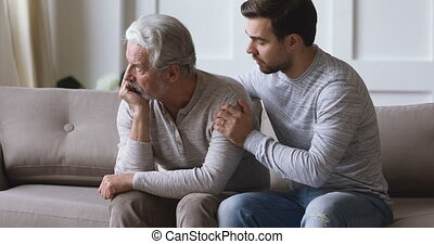 Guilty wrong young adult grown son apologize stubborn upset old senior father say sorry ask for forgiveness regret mistake make peace in difficult two generations age men family relationship concept