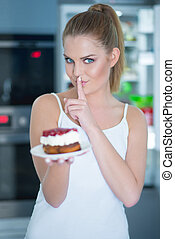 Guilty young woman preparing to eat a cake