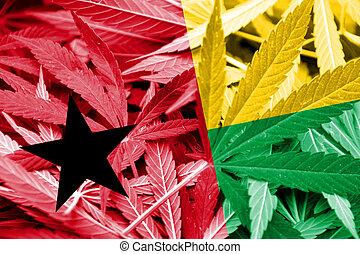 Guinea Bissau Flag on cannabis background. Drug policy. ...