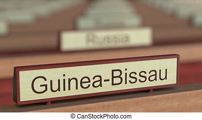Guinea-Bissau name sign among different countries plaques at...