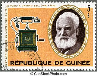GUINEA - CIRCA 1976: A stamp printed by Guinea shows Alexander Graham Bell (1847-1922), telephone, circa 1976