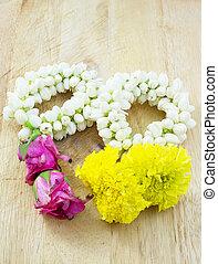 guirlande fleur, sur, plancher bois
