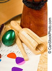 Guiro and egg shaker with other music instruments - Vertical...