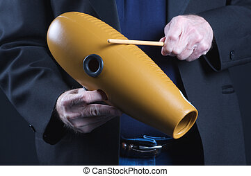 Guiro Goard Being Played - A guiro gourd percussion...